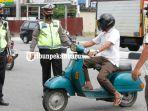 foto_sebelas_warga_pekanbaru_terjaring_saat_razia_masker_di_jalan_tuanku_tambusai_2.jpg