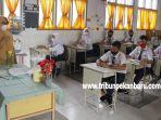 foto_suasana_belajar_tatap_muka_hari_pertama_di_smpn_3_pekanbaru_5.jpg