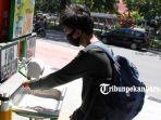 foto_warga_pekanbaru_manfaatkan_tempat_cuci_tangan_di_ruang_publik_3.jpg