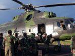helikopter-milik-tni-yang-digunakan-untuk-mengevakuasi-para-korban-pekerja-di-nduga-papua.jpg