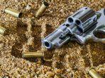 ilustrasi-pistol-dan-peluru.jpg