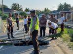 jalan_amblas_di_jalan_lintas_pekanbaru-kuansing_km_52_desa_kebun_durian.jpg