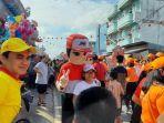 jne_pekanbaru_antarkan_kebahagiaan_dalam_festival_cian_cui.jpg