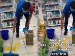 karyawan-minimarket-sabar-membersihkan-telur1.jpg