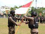 kerusuhan-papua-berakhir-100-personel-brimob-polda-riau-kembali-ke-pekanbaru-bawa-cerita-patriotik.jpg