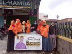 ketua_dprd_pekanbaru_bagi_takjil_semoga_meringankan_beban_masyarakat.jpg