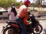 kisah-peserta-seleksi-cpns-2021-suami-istri-tempuh-perjalanan-antar-pulau-pakai-sepeda-motor.jpg