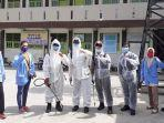 mahasiswa-kukerta-unri-bantu-penyemprotan-disinfektan-dan-rapid-test-massal-di-marpoyan-damai.jpg