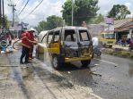 mobil_terbakar_mendadak_di_jalan_kaharuddin_nasution_pekanbaru_begini_kronologinya.jpg