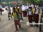murid-sd-di-pekanbaru-akhirnya-diliburkan-karena-kabut-asap_4.jpg
