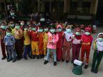 murid_sd_di_pekanbaru_mulai_kenakan_masker_di_sekolah-karena-kabut-asap.jpg