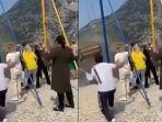ngeri-video-dua-orang-perempuan-jatuh-dari-ayunan-1800-meter-viral-tiba-tiba-tali-ayunan-putus.jpg