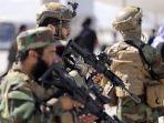 pejuang-unit-militer-taliban-badri-313-berjaga-di-bandara-di-kabul-pada-14-september-2021.jpg