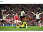 pemain-liverpool-naby-keita-tengah-merayakan-golnya-ke-gawang-manchester-united.jpg