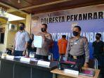 pemalsuan_surat_hasil_tes_swab_pcr_covid-19_pimpinan_perusahaan_dan_anak_buah_ditangkap_di_pekanbaru.jpg