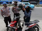 pemeriksaan-kendaraan-saat-psbb-di-pekanbaru-1.jpg