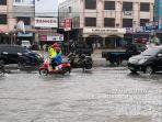 pengaturan-lalu-lintas-saat-banjir-pekanbaru.jpg