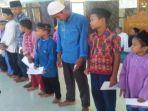pengurus-pkk-desa-muntai-bagikan-santunan-anak-yatim-bersama-yayasan-asiyah-berbagi.jpg