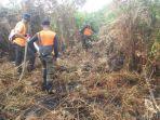 petugas-bpbd-sedang-berupaya-melakukan-pemandam-kebakaran-hutan-dan-lahan.jpg