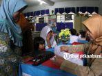 ppdb_foto_mendaftarkan_anak_bersekolah_di_sd_negeri_di_pekanbaru_4jpg.jpg