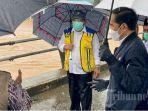 presiden-jokowi-meninjau-sejumlah-lokasi-yang-terdampak-banjir-di-banjar-kalsel.jpg