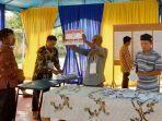 proses-penghitungan-suara-di-tps-028-kelurahan-kerinci-kota-kecamatan-pangkalan-kerinci.jpg