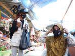 relawan-protokol-kesehatan-pon-xx-kabupaten-jayapura-berikan-masker-dan-edukasi-masyarakat.jpg