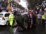 satu-unit-mobil-daihatsu-luxio-bm-8042-tn-terbalik-di-jalan-sudirman-pekanbaru_20180220_090138.jpg