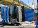 sebuah-truk-kontainer-warna-biru-dengan-nomor-polisi-nopol-bm-9463-xn.jpg