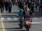 sejumlah-warga-pekanbaru-meramaikan-kawasan-car-free-day-menjelang-masuknya-bulan-ramadan-4_20180513_143708.jpg