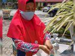 seorang-guru-di-smpn-29-kota-pekanbaru-mencoba-tempat-cuci-tangan.jpg