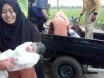 seorang-ibu-melahirkan-di-mobil-bak-terbuka_20170617_120033.jpg