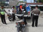 tiga-motor-ditangkap-satlantas-saat-razia-di-jalan-soekarno-hatta-pekanbaru_20170816_175614.jpg