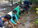 tim-kukerta-balek-kampung-unri-resmikan-spot-foto-mangrove-dan-tanam-bibit-mangrove.jpg
