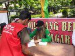 tim-mendata-pelanggar-dalam-razia-masker-di-jalan-kaharuddin-nasution-kota-pekanbaru.jpg
