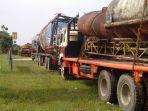 truk-barang-bukti-di-depan-mapolsek-tambang_20171124_150801.jpg