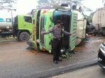 truk-cpo-terguling-di-bandar-sekijang-pelalawan_20170813_163124.jpg