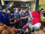 wako-pekanbaru-pasang-masker-pedagang.jpg