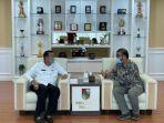 wali-kota-pekanbaru-firdaus-bersama-manager-pln-up3-pekanbaru-yuliandra-syahrial-nurdin.jpg