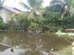 warga-desa-redang-memancing-di-halaman-rumah-yang-banjir_20181107_155017.jpg