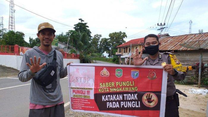 Bhabinkamtibmas Kelurahan Pangmilang Bripka Iswan Susanto Kampanyekan Saber Pungli