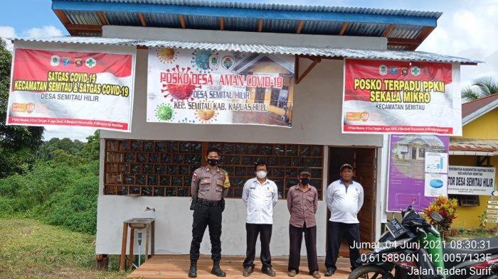 Bhabinkamtibmas Polsek Semitau Cek dan Kontrol Posko PPKM Mikro di Desa Binaan