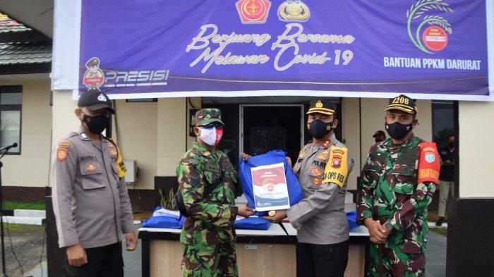 Polres dan Kodim 1208 Sambas Laksanakan Program Bansos Serentak di Kabupaten Sambas