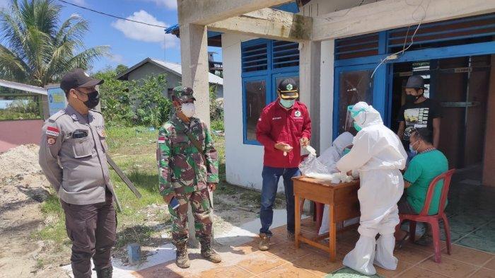 Personel Polsek Ketungau Hulu Kawal Pelaksanaan3T di Desa Nanga Bugau