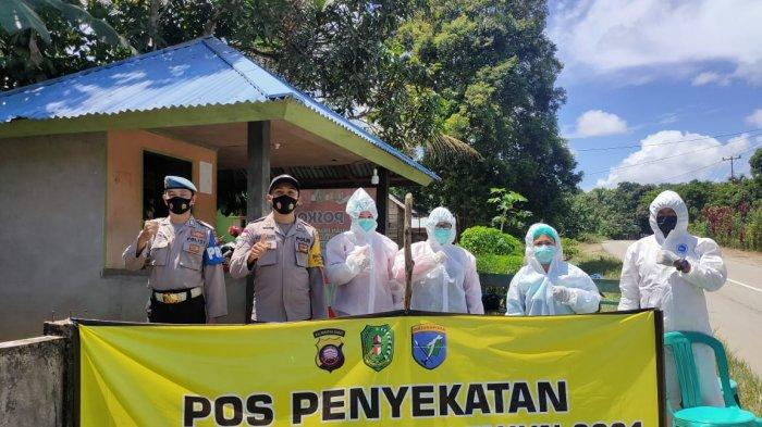 Personel Polsek Ledo Melakukan Penjagaan di Pos Penyekatan Perbatasan Bengkayang- Sambas