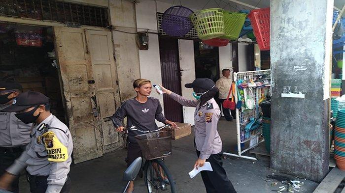 Satuan Tugas Polresta Pontianak Kota Berikan Imbauan Pencegahan Covid-19 Pada Warga