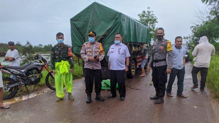 Ruas Jalan Terendam Banjir, Kapolsek Matan Hilir Selatan Imbau Pengendara Berhati-hati