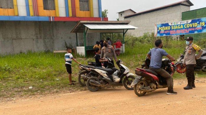 Polsek Kota Baru Gandeng Pemerintah Desa Batu Begigi Dukung Kegiatan PPKM Darurat dan Mikro