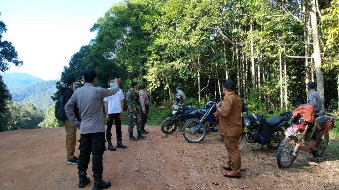 Upaya Memutus Penyebaran Covid-19 di Kabupaten Melawi, Aipda Samsi Cek Pos Perbatasan Kalbar-Kalteng