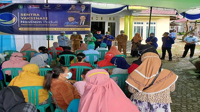 Nasdem Kalbar Gelar Vaksinasi Massal di Desa Kuala Dua Kubu Raya